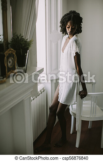 Pretty young african american woman - csp56876840