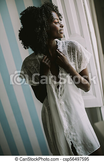Pretty young african american woman - csp56497595