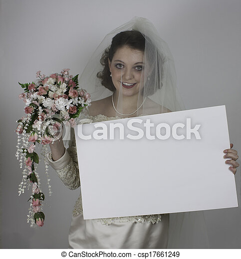 Pretty young bride holding sign - csp17661249