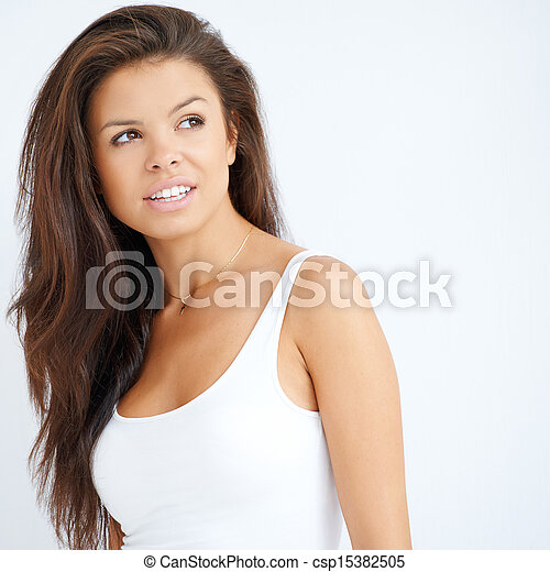 Pretty young brunette woman on white - csp15382505