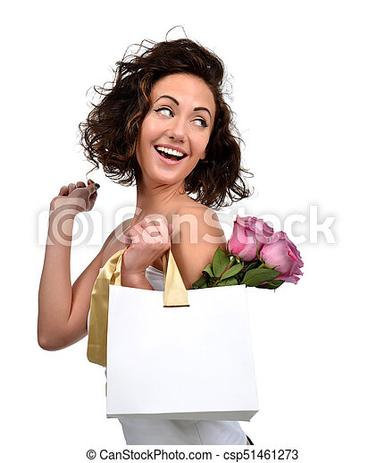 Pretty young brunette woman with shopping bag gold stripes and purple roses flowers - csp51461273