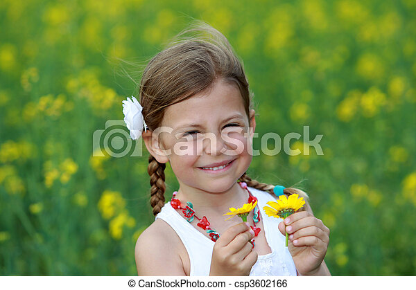 e06597f76e Pretty young girl holding two daisy flowers that she has picked from ...