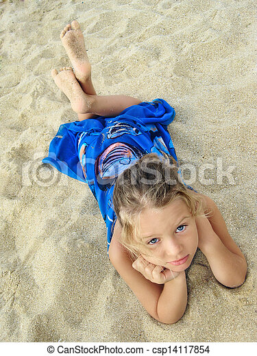 pretty young girl lying on the beach pretty young girl in blue pareo lying on the beach. Black Bedroom Furniture Sets. Home Design Ideas