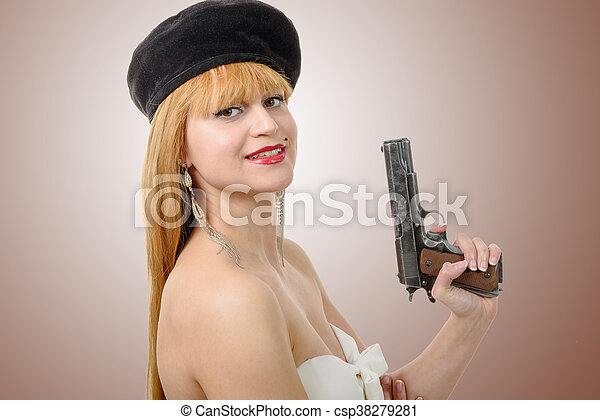 pretty young sexy woman with gun - csp38279281
