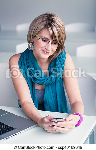 Pretty, young woman at an office - csp40189649