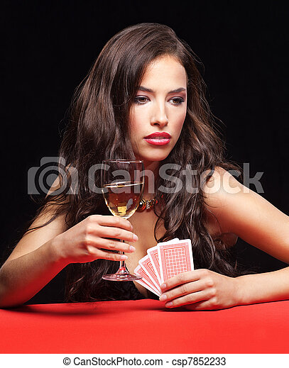 pretty young woman gambling on red table - csp7852233