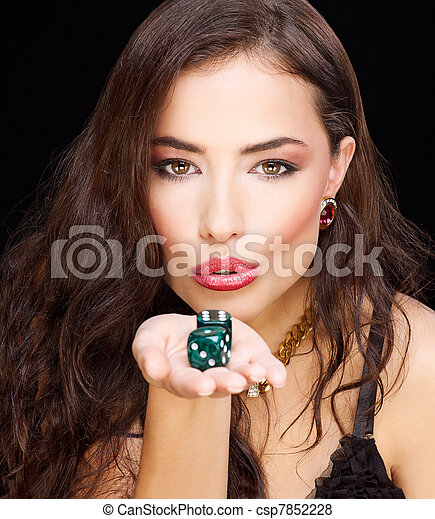 pretty young woman holding dices on black background - csp7852228