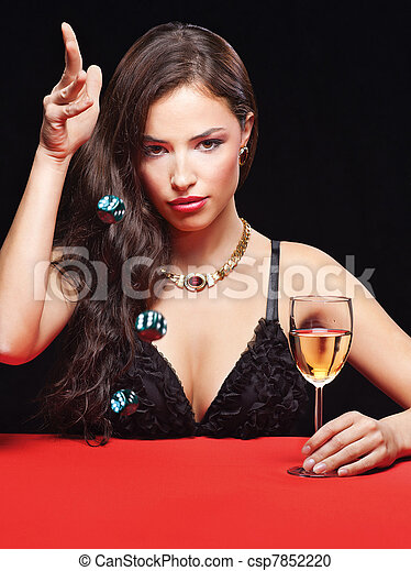 pretty young woman holding dices on red table - csp7852220