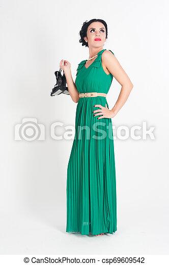 Pretty young woman in long green dress - csp69609542