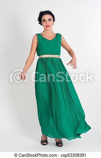 Pretty young woman in long green dress - csp53308391