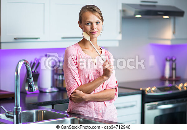 Pretty, young woman posing in her modern kitchen - csp34712946