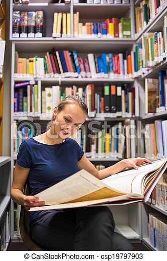 Pretty, young woman studying an old book in archives - csp19797903