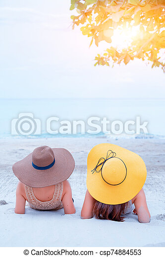 Pride and the LGBTQ+ on summer beach. Bisexual and homosexual love couple. - csp74884553