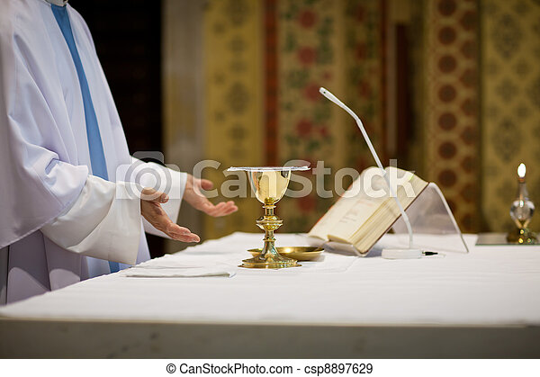 Priest during a wedding ceremony/nuptial mass - csp8897629
