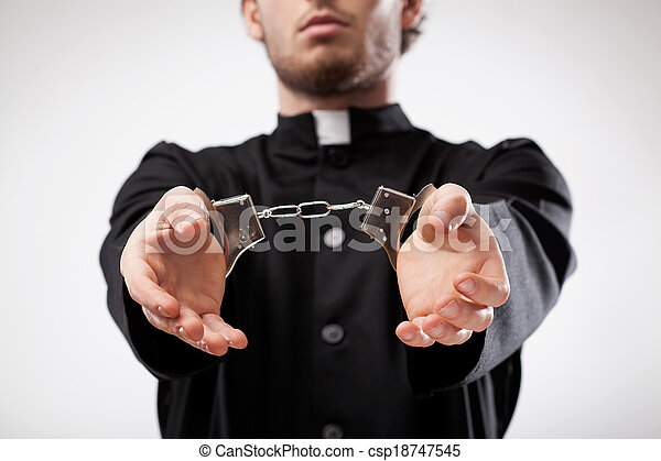 Priest handcuffed - csp18747545