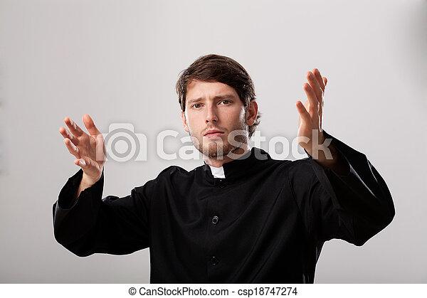 Priest is preaching a sermon - csp18747274