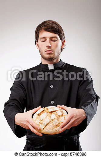 Priest with bread - csp18748398
