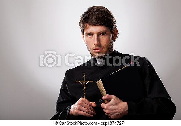 Priest with cross and holy bible - csp18747271