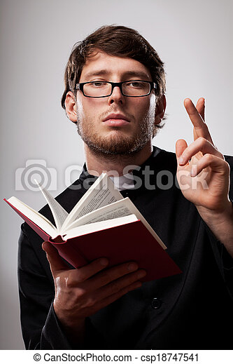 Priest with Holy Bible - csp18747541