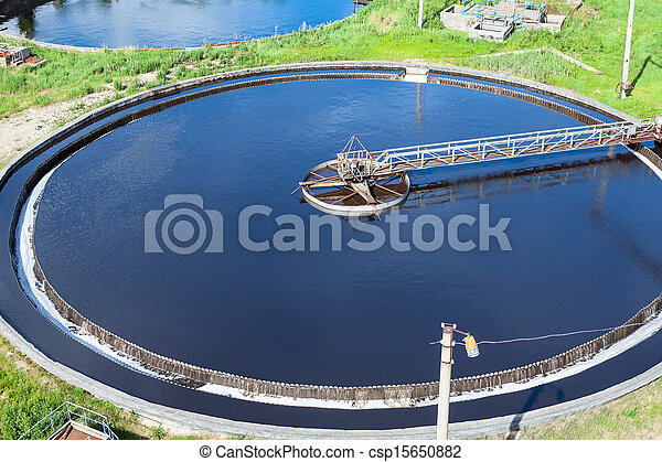Primary round sedimentation basin, sewage flowing through large tanks - csp15650882