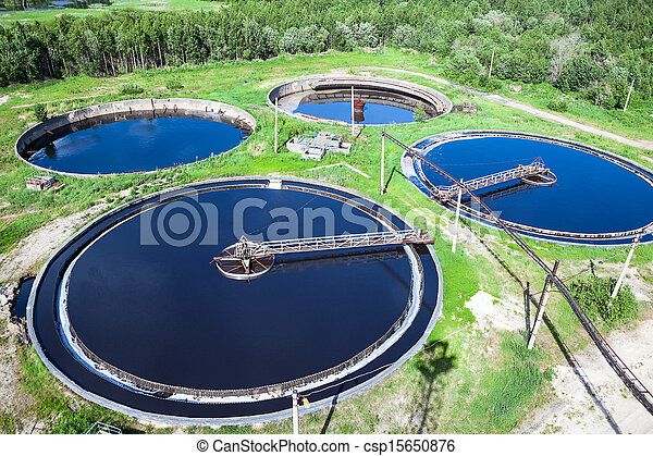Primary sedimentation stage, sewage flowing through large circular tanks with mechanically driven scrapers - csp15650876