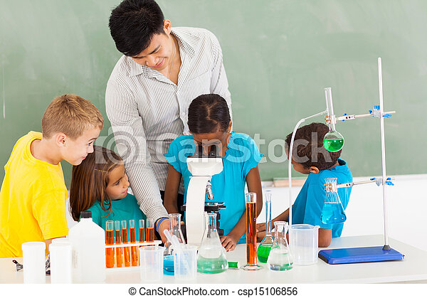 primary teacher and students in science class - csp15106856