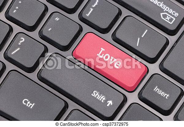 """El primer plano del teclado con el texto de """"Amor"""" en rojo - csp37372975"""