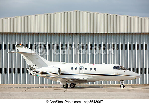 Private jet parked - csp8648067