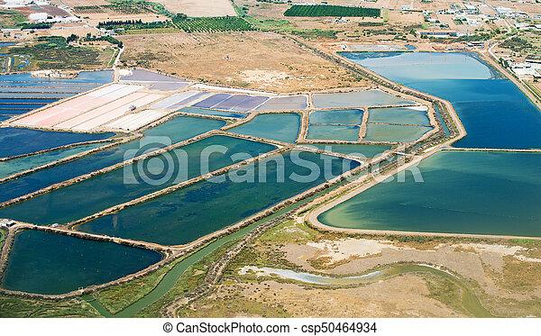 Production of sea salt in the Algarve region, Portugal. - csp50464934