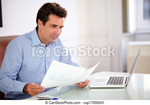 Professiona businessman looking at his documents - csp17009341