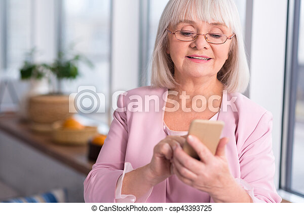 Professional businesswoman looking through her contacts - csp43393725