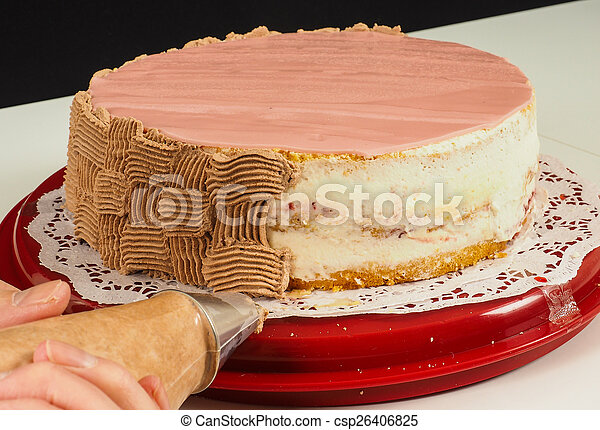 Professional cake baker making the final touch with confectioner - csp26406825