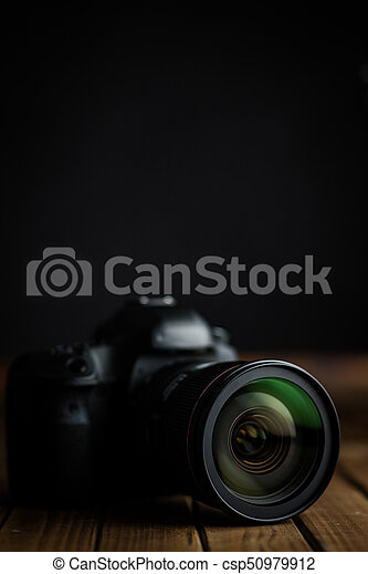Professional camera with lens. - csp50979912