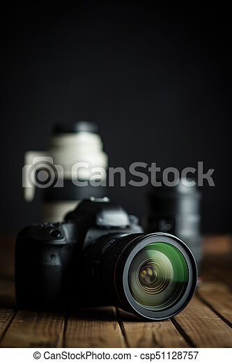 Professional camera with lens. - csp51128757