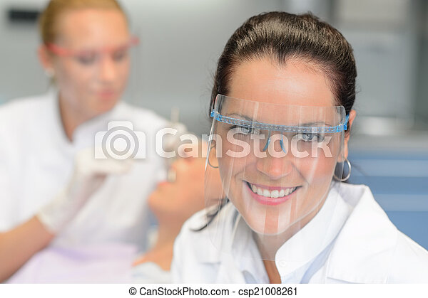 Professional dentist protective glasses patient checkup - csp21008261