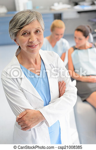 Professional dentist woman patient at dental surgery - csp21008385