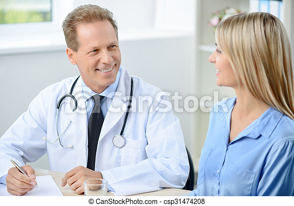 Professional doctor examining his patient  - csp31474208