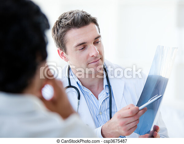 Professional doctor showing the results to his patient  - csp3675487