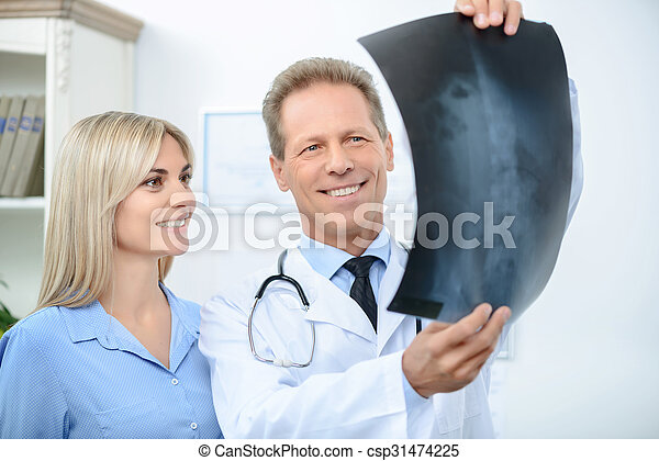 Professional doctor talking with his patient   - csp31474225