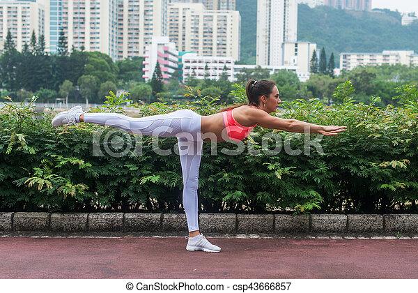 professional female athlete practicing yoga horizontal