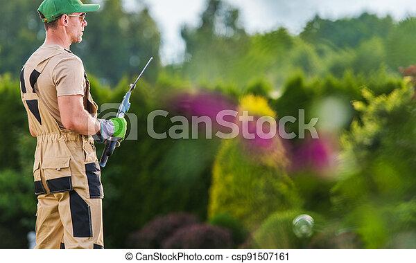 Professional Gardener with His Tools In the Backyard Garden - csp91507161