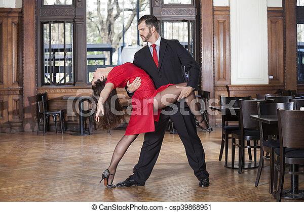 Professional Male And Female Tango Dancers Performing In Restaur - csp39868951