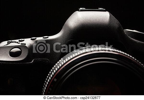 Professional modern DSLR camera low key image  - csp24132877