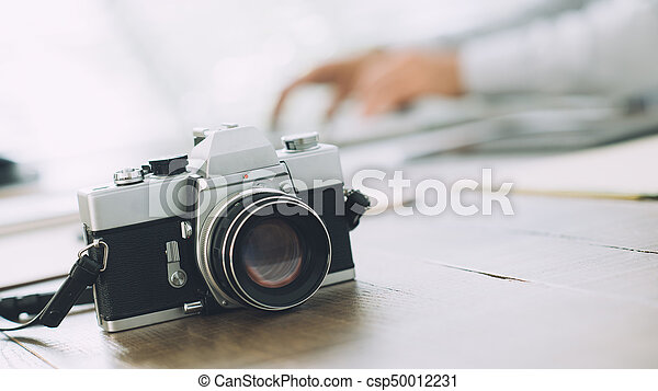Professional photographer at the agency - csp50012231
