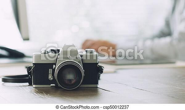 Professional photographer at the agency - csp50012237