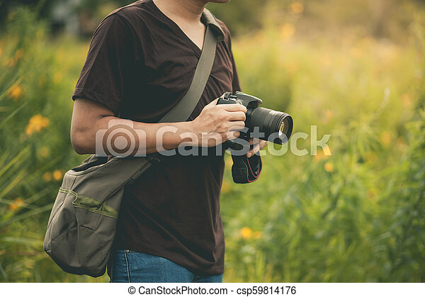 professional photographer with camera. - csp59814176