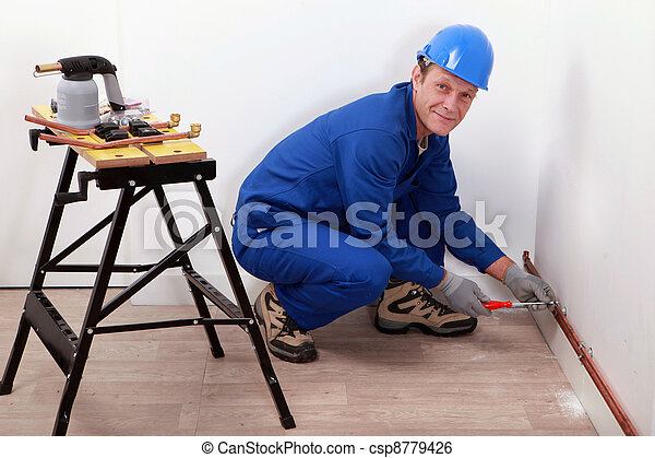 professional repairman working on a wall - csp8779426