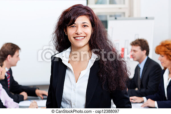 professional successful business woman in office smiling - csp12388097