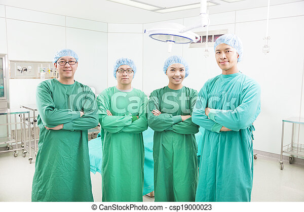 professional surgeon teams standing in a surgical room - csp19000023