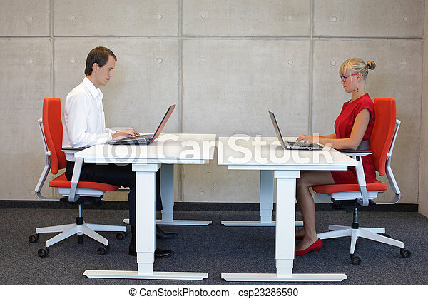 professionals at work stations - csp23286590